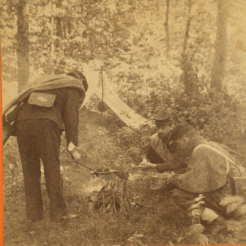 Civil War soldier cooking over a fire http://civilwarvoices.com